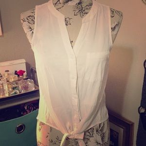 White sleeveless button up slightly cropped top